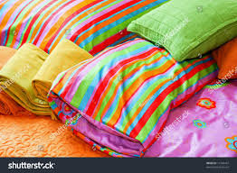 colorful bedding pillows blankets straps stock photo 12146437