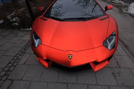 red chrome lamborghini aventador wearing matte red chrome wrap