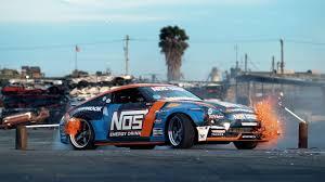 nissan 370z drift car drifting a nissan 370z through a junkyard looks like huge fun