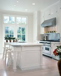 designing and building fine custom cabinetry for 50 years reverence for light this classic kitchen with white walls and cabinetry is offset by the rich walnut island san francisco sophistication