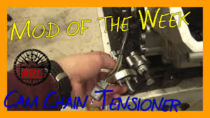 installing an aftermarket manual cam chain tensioner on a dual