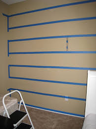 tape designs for painting walls step 1 measure and tape stripe
