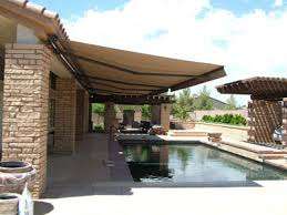Retractable Awning For Deck Blue Retractable Awnings And White Railing Deck Ideas