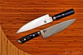 folded steel kitchen knives product photography photographic design