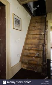 old wooden steep staircase in original kitchen and dining room