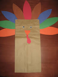 a paper bag turkey paper glue googly and