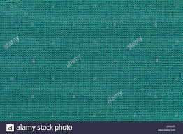 light turquoise background from a textile material with wicker