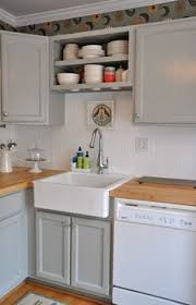 Kvanum Kitchens White Kitchen Cabinets Glossy Black Quartz - Butcher block backsplash