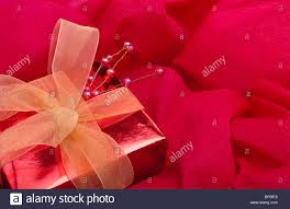 Christmas Crepe Paper Decorations by Christmas Present Parcel Decoration On Red Crepe Paper Background