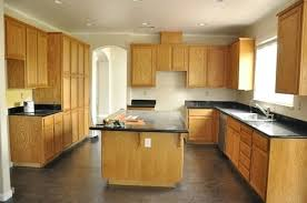 what color granite goes with honey oak cabinets honey oak cabinets with black granite countertops honey oak cabinet