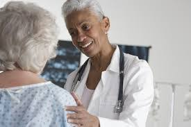 Doctor Comforting Patient Health Resources From Evolvage