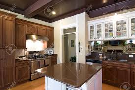 Kitchen Cabinet Refacing Michigan Beautiful Dark Wood And Granite Kitchen With Island Stock Photo