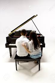 couple with grand piano 1 in white shirt black pants and sundress