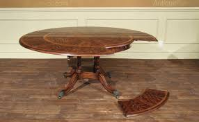 round dining table perimeter leaves round mahogany dining table expands from 50 to 74 inches