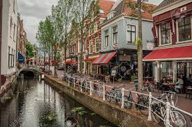 shoing canap shopping with eateries canal brick buildings and bicycles