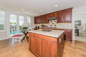 the updated kitchen features granite countertops an island