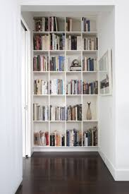 cool small space white wooden built in high end bookshelves design