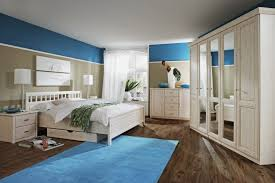 bedroom surfing board sea painting light wooden bed frame blue