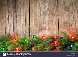 Branch Christmas Tree With Lights - christmas tree branch with lights on grunge wood background stock