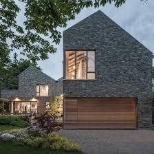 farm buildings inform design of canadian lakeside home by trevor