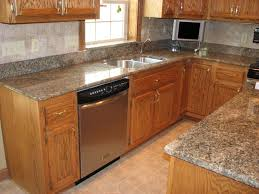 white granite countertops with dark cabinets oak cherry light i on