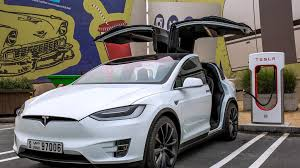 tesla cuts price on model x suv the national