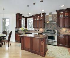 amber cherry mitred raised kitchen cabinets with a brown glaze
