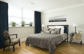 bedroom decor ideas for men with laminate flooring and nightstand