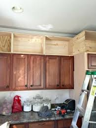 inexpensively update old flat front cabinets by adding trim paint