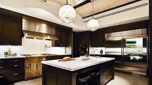 inside ultra luxury kitchens trends among wealthy buyers who designers tired of all white are pushing their clients toward cabinetry in darker hues above a rendering of the kitchens at manhattan s puck penthouses