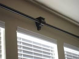 Curtain Rod Sconce Thrifty Window Treatments Window Living Rooms And Decorating