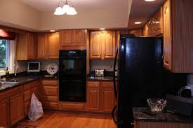 how to paint oak cabinets black updating oak kitchen cabinets before and after 11