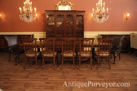 walnut double pedestal dining table with distressed finish