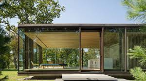 this glass box home is flat out brilliant airows