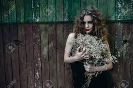 halloween photo backdrop vintage woman as witch posing against the backdrop of an