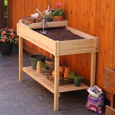 incredible potting bench with wooden soil storage on top combined