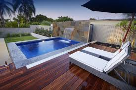 swiming pools stainless fence with wood pool floor also lap pool