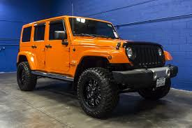 orange jeep wrangler unlimited for sale used 2012 jeep wrangler unlimited sahara 4x4 suv for sale 32395