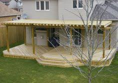 Pergola Deck Designs by Nice Simple Deck With Half Covered In Pergola Plus Box Seat
