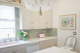 how to cut tile around cabinets how to run kitchen cabinets across a low window the leslie