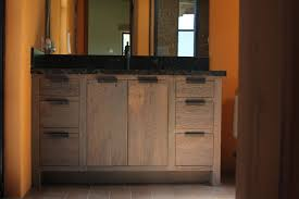 awesome reclaimed wood bathroom vanity with black countertop and