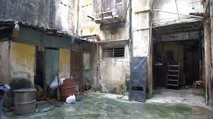 house courtyard inside the courtyard of battered old dirty house in a slum into