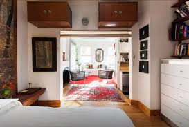 stylish 325 sq ft studio uses a clever design trick create