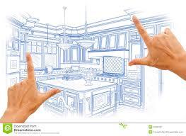hands framing blue custom kitchen design drawing stock photo