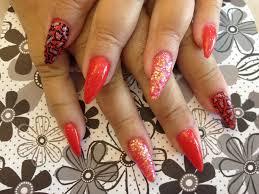 stiletto nails with oriental poppy gel nail polish nail designs