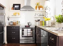 black kitchen cabinets in a small kitchen make a small kitchen look larger with these clever design