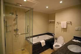 on suite bathroom ideas cream wall paint black ceramic bahttub toilet bidet paper holder