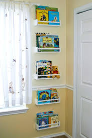 kids room shelves white open shelves with box storage a modern table pile of books
