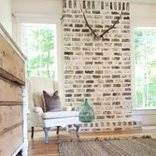 have a red brick fireplace with dark wood mantel this is a great