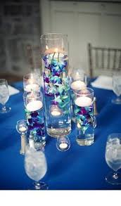 Cylinder Vase Centerpiece by Purple Orchids In Cylinder Vase Filled With Water As Wedding